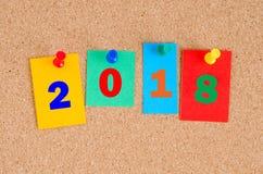 Begreppsmässig anslagstavla om det nya året 2018 Arkivbild