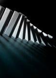 begreppsmässig bild för dominoeffekt Arkivfoton