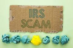 Begreppsmässig handhandstil som visar Irs Scam Affärsfototext som varnar för Pishing för Scam bedrägeriskatt writt för intrig för Royaltyfri Bild