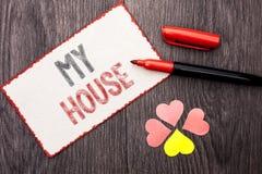 Begreppsmässig handhandstil som visar mitt hus Writte för gods för hushåll för familj för egenskap för hem för hus för affärsfoto arkivfoton