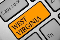 Begreppsmässig handhandstil som visar West Virginia Affärsfoto som ställer ut turen Histor för turism för Amerikas förenta stater royaltyfri fotografi