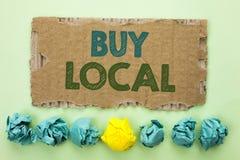 Begreppsmässig lokal för köp för handhandstilvisning Köpet för köpande för affärsfototext lokalt shoppar writte för lagermarknads royaltyfri bild