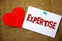 Begreppsmässig sakkunskap för handhandstilvisning Expertis eller kunskap för affärsfototext sakkunnig i en särskild vishet M för  fotografering för bildbyråer