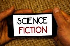 Begreppsmässig science för handhandstilvisning Affärsföretag M för genre för underhållning för fantasi för affärsfototext futuris Arkivfoton