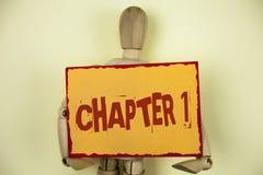 Begreppsmässigt kapitel 1 för handhandstilvisning Start för affärsfototext något som är ny, eller danande de stora ändringarna i  Royaltyfria Foton