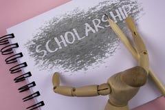 Begreppsmässigt stipendium för handhandstilvisning Affärsfoto som ställer ut lånet eller betalning som göras för att stötta akade Royaltyfri Bild
