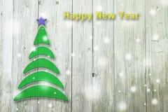Begriffsbaum des neuen Jahres und des Weihnachten auf einem hölzernen Lizenzfreie Stockfotos