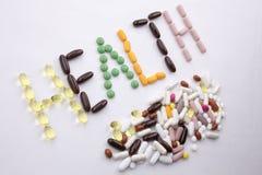 Begriffsgesundheitskonzept medizinische Behandlung der Handschrifttexttitelinspiration geschrieben mit Pillendrogen-Kapselwort stockfotografie