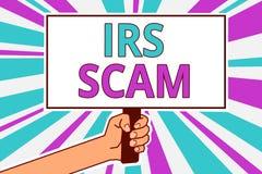 Begriffshandschrift, die IRS Scam zeigt Geschäftsfoto, das gerichtete Steuerzahler durch das Vortäuschen, intern zu sein zur Scha lizenzfreie abbildung