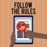 Begriffshandschriftvertretung folgen den Regeln Geschäftsfoto-Textbestellung jemand Stock zu bestimmtem Platzland führt stricts lizenzfreie abbildung