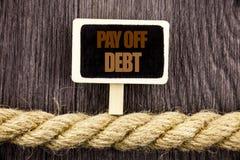 Begriffsschreibenstextvertretung zahlen weg Schuld Geschäftsfoto Präsentationsanzeige zum Zahlen des schuldigen Finanzkredit-Darl Lizenzfreie Stockfotos
