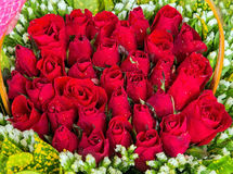 Begroetend rood bloemenboeket Stock Fotografie