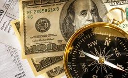 Begroting, kompas en geld Stock Afbeelding