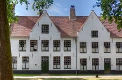 Beguinage Bruges/Brugge, Belgien Arkivfoton