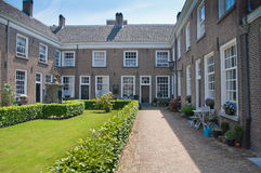 Beguinage in the Dutch city of Breda. The monumental beguinage in the Dutch city of Breda originally dates from the year 1267 Stock Images