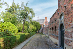 Beguinage with old historic houses downtown in Antwerp, Belgium Royalty Free Stock Photography