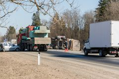 BEGUNITSY, LENINGRAD REGION, VOLOSOVO DISTRICT, RUSSIA - APRIL 13, 2018 Road traffic accident. Truck with sand rolled stock images
