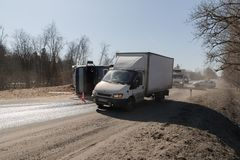 BEGUNITSY, LENINGRAD REGION, VOLOSOVO DISTRICT, RUSSIA - APRIL 13, 2018 Road traffic accident. Truck with sand rolled stock photos