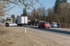 BEGUNITSY, LENINGRAD REGION, VOLOSOVO DISTRICT, RUSSIA - APRIL 13, 2018 Road traffic accident. Truck with sand rolled royalty free stock image