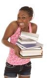 Behälterlächeln-Griffstapel der Frau rosa Bücher Stockbilder