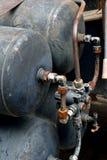 Behållare av gas med röruppsättningen i utrustning Royaltyfri Fotografi