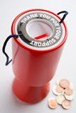 behållare för myntsamling Arkivfoto