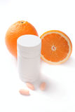 behållare isolerat apelsinpillsvitamin Arkivfoto
