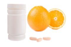 behållare isolerat apelsinpillsvitamin Arkivbild