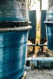Behållare och vattenkran Fotografering för Bildbyråer
