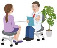 Behandeln Sie und sein weiblicher Patient in seinem Büro Stockfotografie