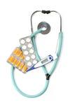 Behandelt Stethoskop, Pillen, Kapsel, Thermometer Lizenzfreie Stockbilder