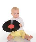 Behandla som ett barn att leka med det gammala vinylrekordet på vitbakgrund Royaltyfria Bilder