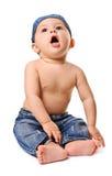 behandla som ett barn att sjunga för pojkejeans arkivbild