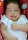 Behandla som ett barn att sova i en hängmatta Arkivfoton