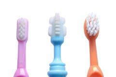 behandla som ett barn bakgrund isolerad tandborstewhite Arkivbild