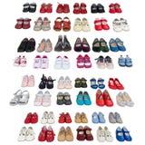 behandla som ett barn bakgrund vita isolerade skor Fotografering för Bildbyråer