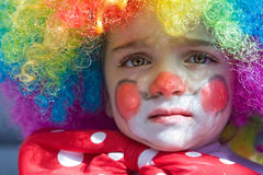 behandla som ett barn clownen Arkivfoton