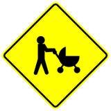 behandla som ett barn crossingteckenstrolleren Royaltyfri Bild
