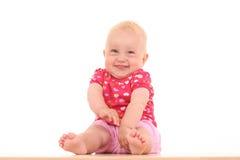 behandla som ett barn den älskvärda flickan Royaltyfri Foto