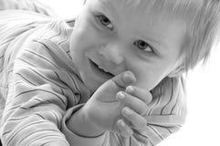 behandla som ett barn den älskvärda pojken Royaltyfri Bild