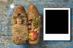 Behandla som ett barn den ögonblickliga fotoramen för jul Jesus Royaltyfri Bild