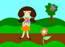 behandla som ett barn den blåa flickaholdingen för fågeln Arkivbild