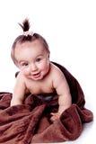 behandla som ett barn den bruna handduken under arkivbild