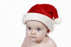 behandla som ett barn den claus hatten santa royaltyfri bild