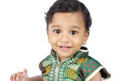behandla som ett barn den gulliga indier Royaltyfria Foton