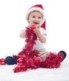 Behandla som ett barn den hållande julprydnaden för pojken Royaltyfri Foto