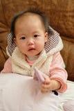 behandla som ett barn den kinesiska flickan Royaltyfri Fotografi