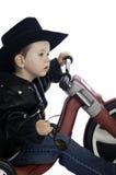 behandla som ett barn den lätta ryttaren arkivfoto