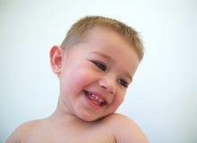 behandla som ett barn den lyckliga pojkeframsidan Royaltyfria Bilder