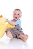 behandla som ett barn den lyckliga pojkeklänningen royaltyfri foto